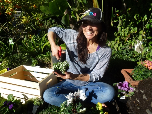 great pic of Dawn cutting flowers to remain in their holders